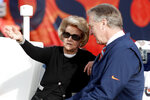 Detroit Lions owner Martha Firestone Ford talks with Denver Broncos president Joe Ellis prior to an NFL football game, Sunday, Dec. 22, 2019, in Denver. (AP Photo/David Zalubowski)