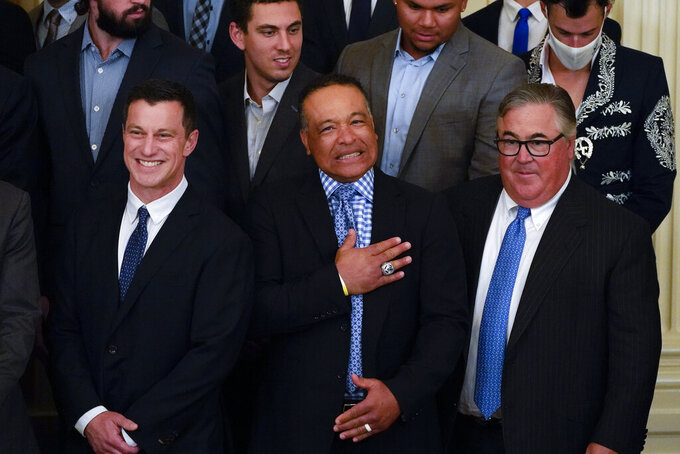 Los Angeles Dodgers manager Dave Roberts reacts during an event to honor the 2020 World Series champion Los Angeles Dodgers baseball team at the White House, Friday, July 2, 2021, in Washington. (AP Photo/Julio Cortez)