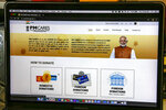 The website of the Prime Minister's Citizen Assistance and Relief in Emergency Situations Fund, or the PM CARES fund, is seen on a computer screen in Kolkata, India, Thursday, July 9, 2020. From industrialists and foreign companies to celebrities and ordinary citizens, people from all walks of life pitched in for a newly created fund touted to strengthen India's fight against the deadly virus the next day. More than three months later, the PM CARES fund, is now valued at more than $1 billion but has since run into controversy over an alleged lack of transparency and accountability, along with a general lack of clarity over the control, the donors and the use of money donated to it. (AP Photo/Bikas Das)