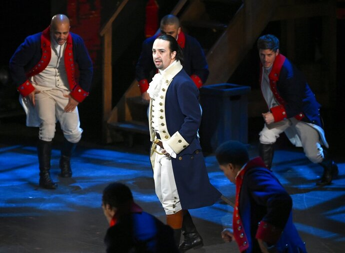 FILE - In this June 12, 2016 file photo, Lin-Manuel Miranda and the cast of