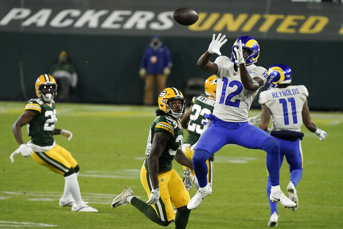 Los Angeles Rams' Van Jefferson leaps to make a catch against the Green Bay Packers during the second half of an NFL divisional playoff football game Saturday, Jan. 16, 2021, in Green Bay, Wis. (AP Photo/Morry Gash)