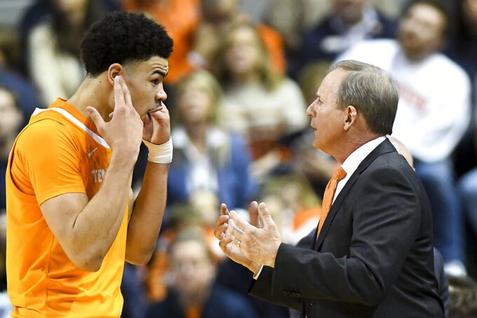 Tennessee forward Olivier Nkamhoua (21) talks with Tennessee head coach Rick Barnes during the first half of an NCAA college basketball game Saturday, Feb. 22, 2020, in Auburn, Ala. (AP Photo/Julie Bennett)