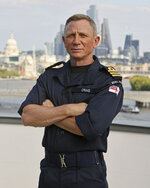 Daniel Craig after receiving the honorary Royal Navy rank of Commander from the Head of the Royal Navy, First Sea Lord Admiral Sir Tony Radakin KCB ADC, in London, Wednesday Sept. 22, 2021. (LPhot Lee Blease/Ministry of Defence via AP)