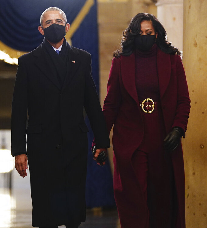 Former President Barack Obama and Michelle Obama arrive in the Crypt of the US Capitol for President-elect Joe Biden's inauguration ceremony on Wednesday, Jan. 20, 2021 in Washington. (Jim Lo Scalzo (Jim Lo Scalzo/Pool Photo via AP)