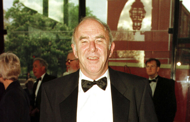 FILE - In this April 24, 1997 file photo, Clive James arrives at the Royal Albert Hall for the BAFTA award ceremony. James, an Australian journalist, joker and intellectual who had a long career as a writer and broadcaster, has died. He was 80. James' representatives, United Agents, said he died Sunday at his home in Cambridge, and a private funeral was held Wednesday, Nov. 27, 2019. (Fiona Hanson/PA via AP, File)