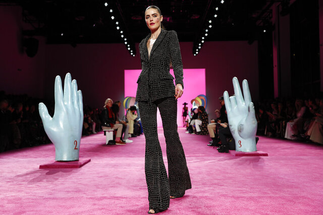 FILE - The Christian Siriano collection is modeled during Fashion Week in New York on Feb. 6, 2020. With no celebs in the front row, no paparazzi chasing models down the streets, no stiletto-heeled crowds and no live shows at all, is there even a point to doing Fashion Week in 2020? Well, yes, say organizers: It's about business. And jobs. And survival. (AP Photo/John Minchillo, File)