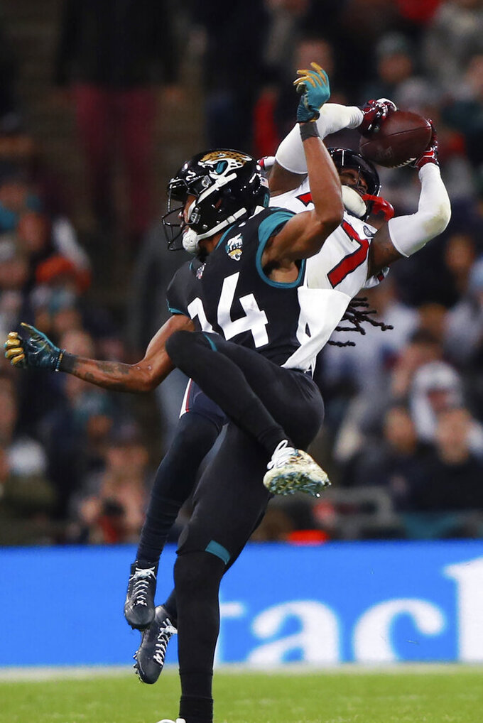 Houston Texans strong safety Jahleel Addae (37) makes the interception against the Jacksonville Jaguars during the second half of an NFL football game at Wembley Stadium, Sunday, Nov. 3, 2019, in London. (AP Photo/Ian Walton)