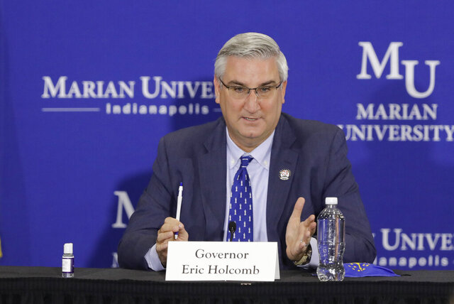 Indiana Gov. Eric Holcomb speaks during a meeting with higher education leaders on safely reopening schools, Friday, July 24, 2020, in Indianapolis. (AP Photo/Darron Cummings)
