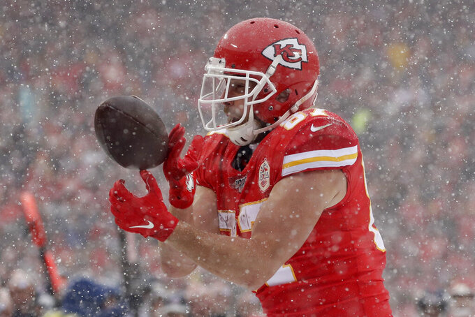 Kansas City Chiefs tight end Travis Kelce (87) can't hold on to the ball during the first half of an NFL football game against the Denver Broncos in Kansas City, Mo., Sunday, Dec. 15, 2019. (AP Photo/Charlie Riedel)