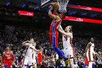 Philadelphia 76ers' Tobias Harris (12) goes up to shoot against Miami Heat's Kelly Olynyk (9) during the second half of an NBA basketball game, Saturday, Nov. 23, 2019, in Philadelphia. (AP Photo/Matt Slocum)