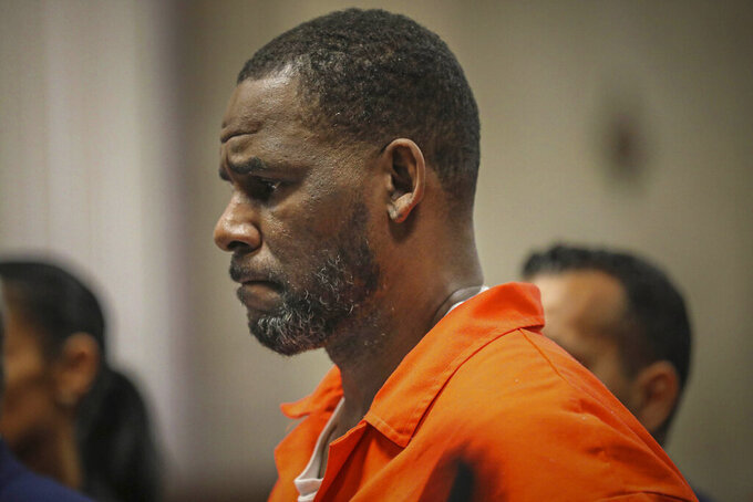 FILE - In this Sept. 17, 2019, file photo, R. Kelly appears during a hearing at the Leighton Criminal Courthouse in Chicago. The R&B star gained weight and lost money while he awaits a sex-trafficking trial that starts in earnest next week, his lawyers said Tuesday, Aug. 3, 2021, at a court hearing. The revelations came as U.S. District Judge Ann M. Donnelly in New York made a series of rulings to narrow down what evidence can be shown to jurors.  (Antonio Perez/Chicago Tribune via AP, Pool, File)