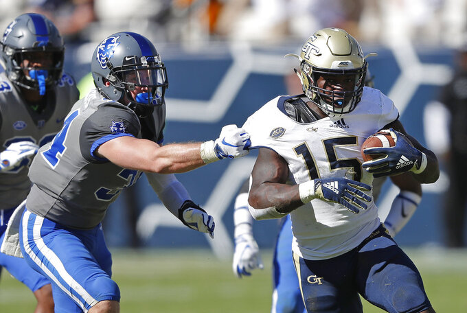Georgia Tech running back Jerry Howard (15) is grabbed by Duke linebacker Ben Humphreys (34) during the second half of the an NCAA college football game, Saturday, Oct. 13, 2018, in Atlanta. Duke won 28-14. (AP Photo/John Bazemore)