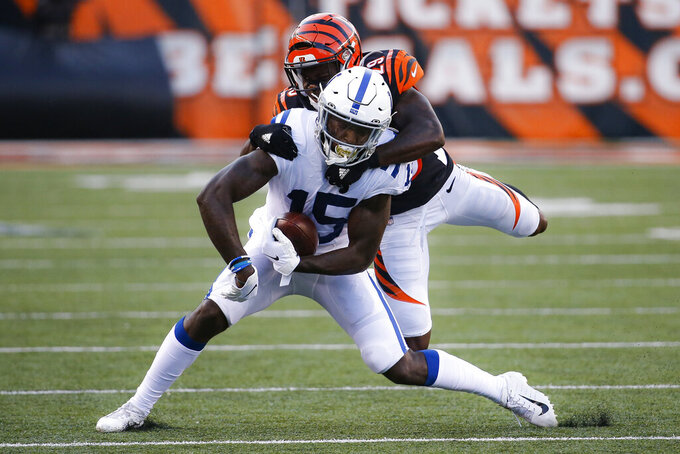 Indianapolis Colts wide receiver Parris Campbell (15) is tackled on the run by Cincinnati Bengals cornerback Tony McRae (29) during the first half of an NFL preseason football game Thursday, Aug. 29, 2019, in Cincinnati. (AP Photo/Frank Victores)