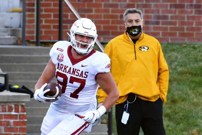 Arkansas tight end Blake Kern (87) celebrates after scoring during the first half of an NCAA college football game against Missouri Saturday, Dec. 5, 2020, in Columbia, Mo. (AP Photo/L.G. Patterson)