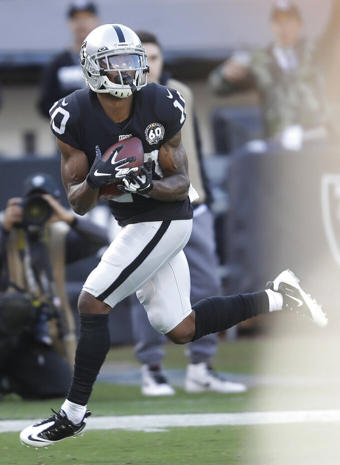 Oakland Raiders wide receiver Rico Gafford (10) catches a touchdown pass against the Tennessee Titans during the first half of an NFL football game in Oakland, Calif., Sunday, Dec. 8, 2019. (AP Photo/Ben Margot)