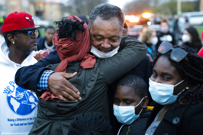 The Rev. Jesse Jackson greets demonstrators during a protest over the fatal shooting of Daunte Wright by a police officer during a traffic stop, outside the Brooklyn Center Police Department, Saturday, April 17, 2021, in Brooklyn Center, Minn. (AP Photo/John Minchillo)