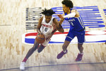 Houston Rockets' Jalen Green (0) drives to the basket under pressure from Detroit Pistons' Cade Cunningham (2) during the second half of an NBA summer league basketball game Tuesday, Aug. 10, 2021, in Las Vegas. (AP Photo/Chase Stevens)