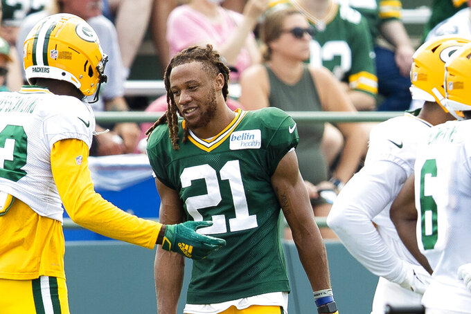 Green Bay Packers cornerback Eric Stokes (21)  talks with teammates during NFL football training camp, Thursday, Aug. 5, 2021, in Green Bay, Wis. (Samantha Madar/The Post-Crescent via AP)