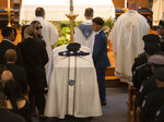 Jennifer Familia, wife of fallen Worcester Police Officer Enmanuel Familia, stands next to his casket across from their son Jovan Familia during his funeral Mass at St. John Church in Worcester, Mass. Thursday, June 10, 2021. (Ashley Green/Worcester Telegram & Gazette via AP)