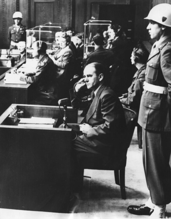 FILE - In this Sept. 12, 1946 file photo, Albert Speer, Hitler's former architect and armament minister during WW II, a defendant in the war crimes trial at Nuremberg, Germany is pictured in court in Nuremberg. Germany marks the 75th anniversary of the landmark Nuremberg trials of several Nazi leaders and in what is now seen as the birthplace of a new era of international law on Friday, Nov. 20, 2020. (AP Photo, file)