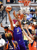 Phoenix Mercury center Brittney Griner, center, scores over the defense of Connecticut Sun guards Jasmine Thomas, left, and Rachel Banham during a WNBA basketball game Friday, July 12, 2019, in Uncasville, Conn. (Sean D. Elliot/The Day via AP)