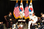 South Korean President Moon Jae-in, left, meets with Adm. John Aquilino, U.S. Navy Commander, U.S. Indo-Pacific Command, Wednesday, Sept. 22, 2021, in Honolulu. South Korean soldiers who died in the Korean War had been in the possession of the U.S. Defense POW/MIA Accounting Agency until Wednesday, when they were placed on a Korean government jet to be returned home, the Honolulu Star-Advertiser reported. (Craig T. Kojima/Honolulu Star-Advertiser via AP)