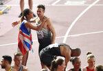Katarina Johnson-Thompson, of Great Britain, winner of the women's heptathlon embraces Niklas Kaul, of Germany, winner of the men's decathlon at the World Athletics Championships in Doha, Qatar, Thursday, Oct. 3, 2019. (AP Photo/Martin Meissner)