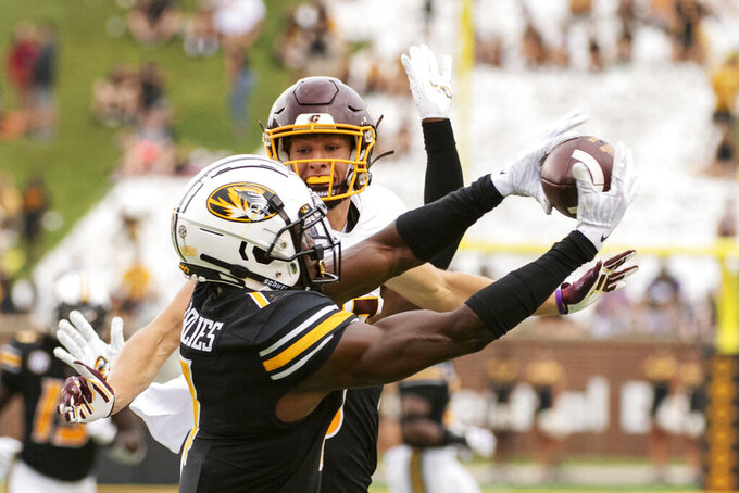 Missouri defensive back Jaylon Carlies, left, intercepts the ball in front of Central Michigan wide receiver Finn Hogan, right, during the third quarter of an NCAA college football game Saturday, Sept. 4, 2021, in Columbia, Mo. (AP Photo/L.G. Patterson)