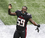 Atlanta Falcons linebacker LaRoy Reynolds celebrates a victory over the Las Vegas Raiders during the fourth quarter of an NFL football game on Sunday, Nov 29, 2020, in Atlanta. (Curtis Compton/Atlanta Journal-Constitution via AP)
