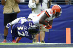 Cleveland Browns wide receiver Jarvis Landry (80) is tackled just shy of the goal line by Baltimore Ravens defensive back DeShon Elliott (32) during the third quarter of an NFL football game Sunday, Sept. 29, 2019, in Baltimore. Landry, who did not return to the game after that play, remains in concussion protocol following the game in which he caught eight passes for a career-high 167 yards in Sunday's 40-25 victory. Coach Freddie Kitchens said Thursday that Landry is still out, and it's not yet known if he'll be available Monday night when the Browns (2-2) visit the San Francisco 49ers (3-0). Landry has also been returning punts this season. (AP Photo/Gail Burton)