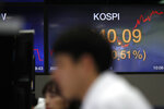 Currency traders watch computer monitors near the screen showing the Korea Composite Stock Price Index (KOSPI) at the foreign exchange dealing room in Seoul, South Korea, Wednesday, May 27, 2020. Major Asian stock markets have declined as US-Chinese tension over Hong Kong competes with optimism about recovery from the coronavirus pandemic.(AP Photo/Lee Jin-man)