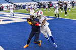 Los Angeles Chargers wide receiver Keenan Allen (13) catches a touchdown pass against Buffalo Bills cornerback Taron Johnson (24) during the second half of an NFL football game, Sunday, Nov. 29, 2020, in Orchard Park, N.Y. (AP Photo/Adrian Kraus )