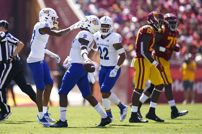 San Jose State safety Jay Lenard, second from left, celebrates after recovering a fumble during the first half of an NCAA college football game against Southern California Saturday, Sept. 4, 2021, in Los Angeles. (AP Photo/Ashley Landis)