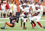 Syracuse defensive back Adrian Cole (10) jersey tackles Rutgers wide receiver Aron Cruickshank (2) in the second half of an NCAA college football game, Saturday, Sept. 11, 2021, at the Carrier Dome in Syracuse, N.Y. (Dennis Nett/The Post-Standard via AP)