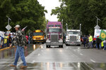 A convoy of trucks and tractors circle the Oregon state Capitol on Thursday, June 27, 2019 in Salem, Ore. Protesters are supporting the eleven Republican senators who walked out over a week ago to avoid a vote on climate legislation. (Michaela Roman/Statesman-Journal via AP)