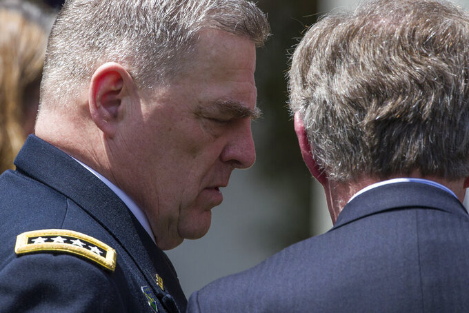 Army Chief of Staff Gen. Mark Milley, left, talks with national security adviser John Bolton after the presentation of the Commander-in-Chief's Trophy to the U.S. Military Academy at West Point football team, in the Rose Garden of the White House, Monday, May 6, 2019, in Washington. (AP Photo/Alex Brandon)