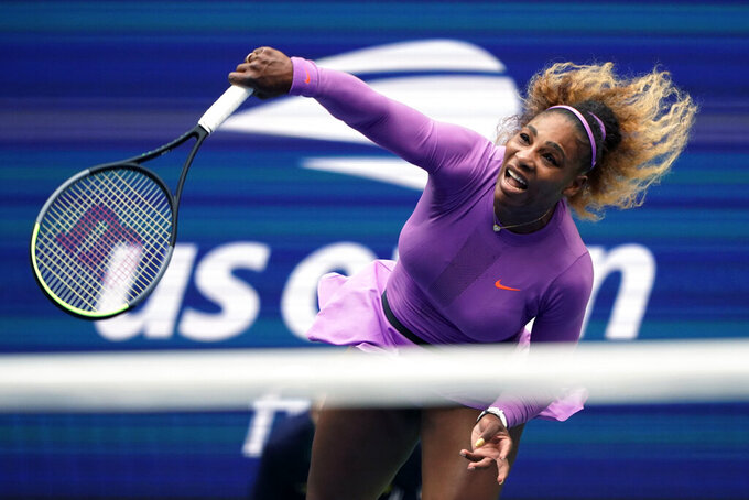 """FILE - In this Sept. 7, 2019, file photo, Serena Williams returns a shot to Bianca Andreescu, of Canada, during the women's singles final of the U.S. Open tennis championships in New York. Serena Williams is planning to play in the 2020 U.S. Open. The 23-time Grand Slam singles champion said in a video shown during the U.S. Tennis Association's tournament presentation Wednesday, June 17, 2020, that she """"cannot wait to return"""" to New York for the major championship she has won six times. (AP Photo/Eduardo Munoz Alvarez, File)"""