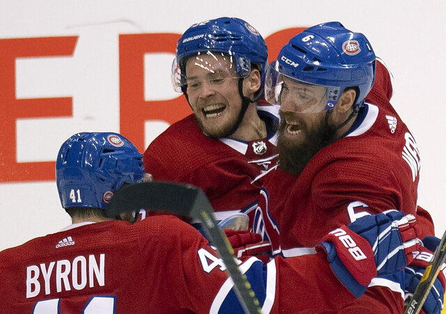 Montreal Canadiens left wing Artturi Lehkonen (62) celebrates his game and series winning goal against the Pittsburgh Penguins with teammates Shea Weber (6) and Paul Byron (41) during the third period of an NHL hockey playoff game Friday, Aug. 7, 2020, in Toronto. (Frank Gunn/The Canadian Press via AP)