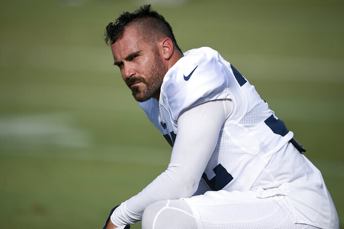 FILE - In this July 30, 2019, file photo, Los Angeles Rams safety Eric Weddle attends an NFL football training camp in Irvine, Calif. Weddle and nearly every Rams starter did not participate at all in the just-completed preseason, and they will not get their first real game action together until Sunday, Sept. 8, 2019, in their regular season opener at Carolina. The veteran safety appears to be fitting in splendidly with his new defense, but he will not know exactly how he fits until they finally get on the field together. (AP Photo/Kelvin Kuo, File)