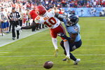Tennessee Titans cornerback Adoree' Jackson (25) breaks up a pass intended for Kansas City Chiefs wide receiver Tyreek Hill (10) in the second half of an NFL football game Sunday, Nov. 10, 2019, in Nashville, Tenn. (AP Photo/Mark Zaleski)