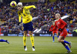Sweden forward Lina Hurtig, left, heads the ball away from United States midfielder Lindsey Horan during the first half of a women's international friendly soccer match in Columbus, Ohio, Thursday, Nov. 7, 2019. (AP Photo/Paul Vernon)