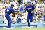 Los Angeles Dodgers' Trea Turner, right, gets congratulations from third base coach Dino Ebel after hitting a solo home run against the New York Mets during the first inning of a baseball game in Los Angeles, Saturday, Aug. 21, 2021. (AP Photo/Alex Gallardo)
