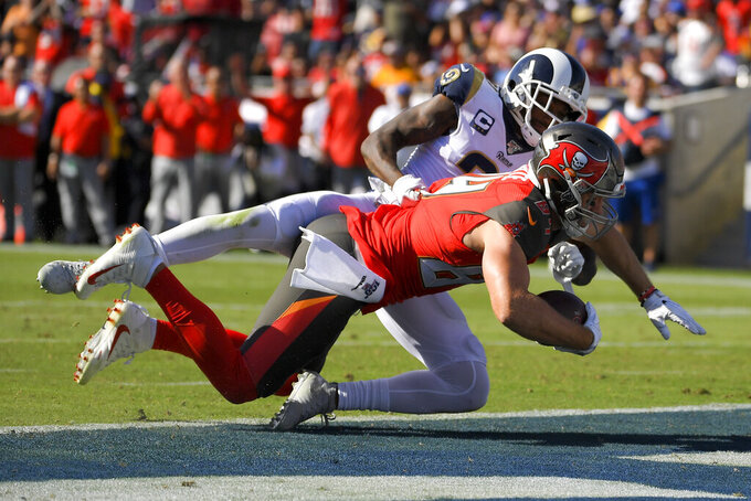 Tampa Bay Buccaneers tight end Cameron Brate scores past Los Angeles Rams cornerback Aqib Talib during the second of an NFL football game Sunday, Sept. 29, 2019, in Los Angeles. (AP Photo/Mark J. Terrill)