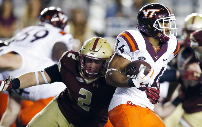 FILE - In this Oct. 7, 2017, file photo, Boston College's Zach Allen (2) defends against Virginia Tech's Travon McMillian (34) during the second half of an NCAA college football game in Boston. Allen was a three-star recruit who has blossomed into a star for the Eagles, going from 250 as a freshman to 285 heading into his senior season. (AP Photo/Michael Dwyer, File)