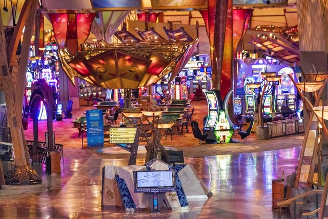 FILE — This May 21, 2020 file photo shows a general view of the Mohegan Sun casino, in Uncasville, Conn. The Mohegan Sun casino said Friday, Aug. 14, it will lay off an unspecified number of employees due to impacts from the coronavirus pandemic. The southeastern Connecticut casino on sovereign tribal land opened June 1 despite opposition from Gov. Ned Lamont over the potential danger of spreading the virus in large group settings.(AP Photo/Mary Altaffer, File)