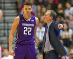 FILE - In this Dec. 1, 2018, file photo, Northwestern head coach Chris Collins, right, talks with forward Pete Nance (22) during a break in the first half of an NCAA college basketball game against Indiana n Bloomington, Ind. Northwestern hopes to find its footing coming off back-to-back losing seasons since the school that hosted the NCAA's inaugural Final Four made the tournament for the first time. (AP Photo/Doug McSchooler, File)