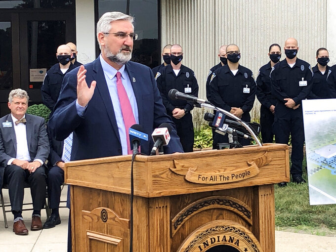 Indiana Gov. Eric Holcomb speaks during a bill signing ceremony at the Indiana Law Enforcement Academy in Plainfield, Ind., Monday, Aug. 16, 2021. Holcomb told reporters afterward that he supported the growing number of Indiana school districts issuing mask mandates for students and staff as they try to head off more COVID-19 outbreaks. (AP Photo/Tom Davies)