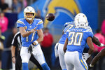 Los Angeles Chargers quarterback Philip Rivers, left, passes to running back Austin Ekeler during the first half of an NFL football game against the Pittsburgh Steelers, Sunday, Oct. 13, 2019, in Carson, Calif. (AP Photo/Kelvin Kuo)