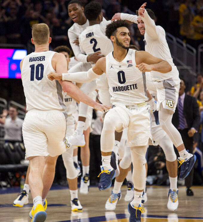 Marquette players celebrate beating Villanova during an NCAA college basketball game Saturday, Feb. 9, 2019, in Milwaukee. Marquette defeated Villanova 66-65. (AP Photo/Darren Hauck)