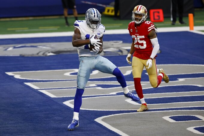 Dallas Cowboys wide receiver Michael Gallup (13) catches a touchdown pass in front of San Francisco 49ers cornerback Richard Sherman (25) in the first half of an NFL football game in Arlington, Texas, Sunday, Dec. 20, 2020. (AP Photo/Ron Jenkins)